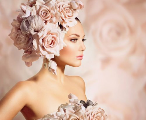 Beautiful woman with rose headpiece
